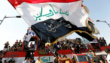 Iraqi demonstrators gather to mark the first anniversary of the anti-government protests in Baghdad, Iraq, October 25, 2020.