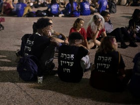 "Youth wear shirts reading ""Avera is still alive"" at a Tel Aviv rally in support of the Israeli citizen held captive by Hamas in Gaza, September 8, 2019."