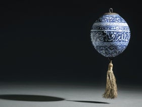 An early Iznik blue and white calligraphic pottery hanging ornament, Turkey, circa 1480 (est. £200,000-300,000)