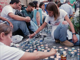 Youth gather at the Tel Aviv site of the murder of Prime Minister Yitzhaq Rabin, a year after his assassination, October 24, 1996.