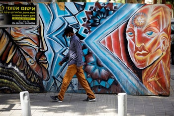 An African migrant walks along a street in south Tel Aviv, October, 25, 2020.