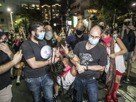 Plainclothes police officers arrest a protester at an anti-Netanyahu demonstration in Tel Aviv, October 2020.