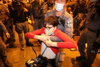 Arrest of a protester at an anti-Netanyahu demonstration near the prime minister's official residence in Jerusalem, October 24, 2020.