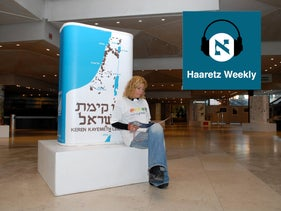 A woman at a 2006 exhibition honoring the iconic Jewish National Fund blue box.