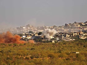 Smoke plumes rise from buildings in the village of Kansafra, in the southern countryside of Syria's rebel-held northwetern Idlib province, October 23, 2020.