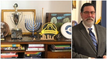 Mayor Bill Peduto, right, and the blue menorah on a desk in his office.