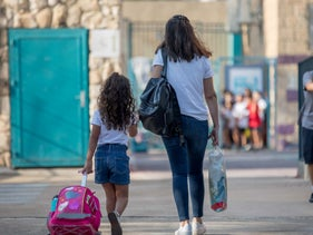 A mother and daughter in Jerusalem on the first day of school on September 1, 2020.