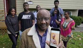 Sophonie Bizimana, center, a permanent U.S. resident who is a refugee from Congo, poses for a photo, W at his home in Kirkland, Washington, October 14, 2020.