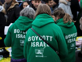 Demonstrators wear shirts reading 'Boycott Israel' in Paris, France, Dec. 9, 2017.
