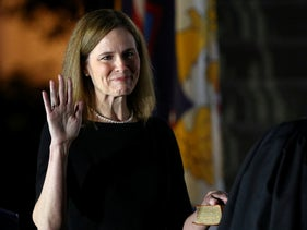 Judge Amy Coney Barrett is sworn in as an associate justice by Supreme Court Justice Clarence Thomas on the South Lawn of the White House, October 26, 2020.