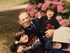Abraham Grossman pictured with two of his grandsons.