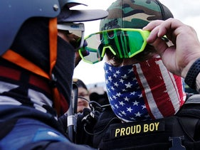 A member of the Proud Boys, right, standing in front of a counterprotester as members of the Proud Boys and other right-wing demonstrators rally in Portland, September 26, 2020.