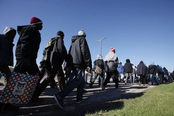 Refugees march to Jerusalem in protest of their worsening conditions, December 2013.