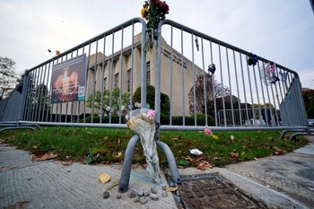 Stones and flowers are placed on the sidewalk outside the Tree of Life synagogue in Pittsburgh, on the second anniversary of the shooting that killed 11 worshipers, October 27, 2020.