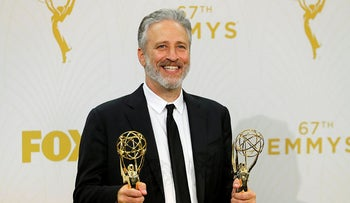 "Jon Stewart holds his awards for Outstanding Writing For A Variety Series and Outstanding Variety Talk Series for Comedy Central's ""The Daily Show With Jon Stewart"" during the 67th Primetime Emmy Awards in Los Angeles, California September 20, 2015"
