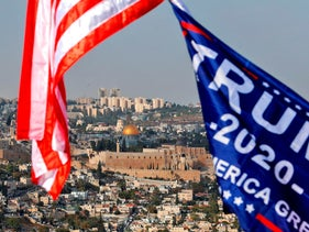 A view of U.S. and Trump campaign flags flying in Jerusalem with the background showing the Dome of the Rock, October 27, 2020