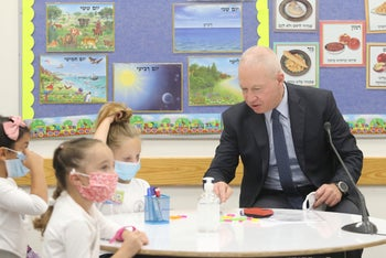 Education Minister Yoav Gallant visits the Neta'im school in the Tel Aviv suburb of Ramat Gan on the first day of the year, September 1, 2020.