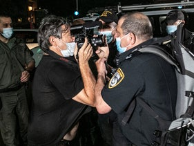 Confrontation between a photographer and a police officer at a demonstration in Tel Aviv, October 10, 2020.