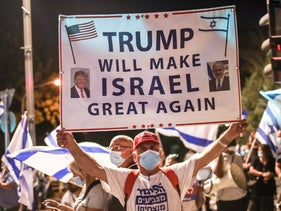 A demonstrator supporting Prime Minister Benjamin Netanyahu holds up a pro-Trump sign in Jerusalem, July 23, 2020.