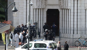 French members of the elite tactical police unit RAID enter to search the Basilica of Notre-Dame de Nice after a knife attack in Nice, October 29, 2020.