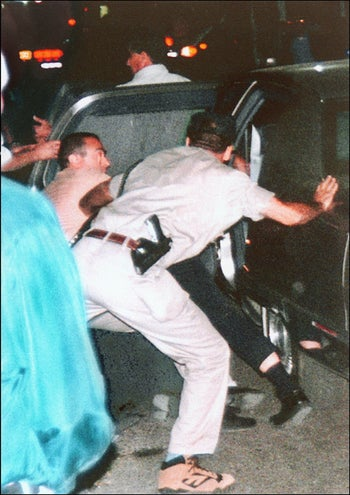 Israeli security agents pushing Prime Minister Yitzhak Rabin into a car after he was mortally wounded in Tel Aviv, November 4, 1995.