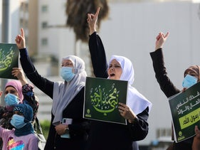 """Protesters hold placards that say """"Mohammad is the prophet of mercy"""" as they demonstrate near the French Embassy, Tel Aviv, October 29, 2020."""