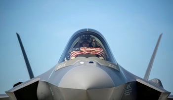 An F-35 pilot prepares for take off from the Vermont Air National Guard Base, before a flyover in South Burlington, Vermont, May 22, 2020.