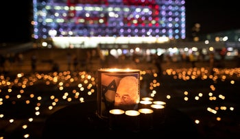 A candle with an image of Yitzhak Rabin at Rabin Square on the 25th anniversary of his assassination according to the Jewish calendar, on October 29, 2020.