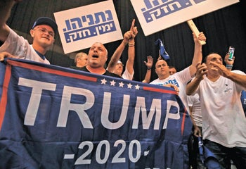 Likud party supporters wave a Trump 2020 electoral banner supporting the incumbent US president in the upcoming election, Tel Aviv, September 18, 2019.