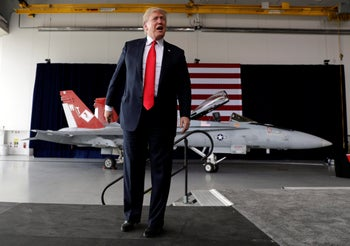 President Donald Trump arrives speaks to service members at Marine Corps Air Station Miramar, San Diego, March 13, 2018.