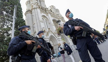 Police officers stand guard by the Notre-Dame de l'Assomption Basilica in Nice, October 29, 2020.