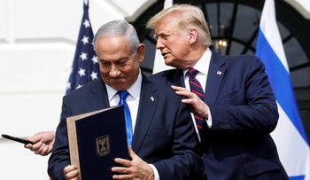 Netanyahu stands with Trump after signing the Abraham Accords, normalizing relations between Israel and some of its Middle East neighbors, on the South Lawn of the White House in Washington, September 15, 2020