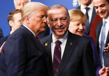 Donald Trump and Recep Tayyip Erdogan leave the stage after family photo during the annual NATO heads of government summit at the Grove Hotel in Watford, Britain, December 4, 2019.