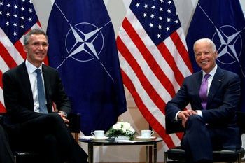 U.S. Vice President Joe Biden meets NATO Secretary General Jens Stoltenberg at the annual Munich Security Conference in Munich, Germany, February 7, 2015.