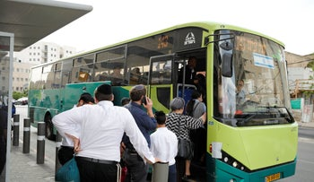 People standing in line to board the 143 Egged bus in Jerusalem, Israel, May 2, 2019.