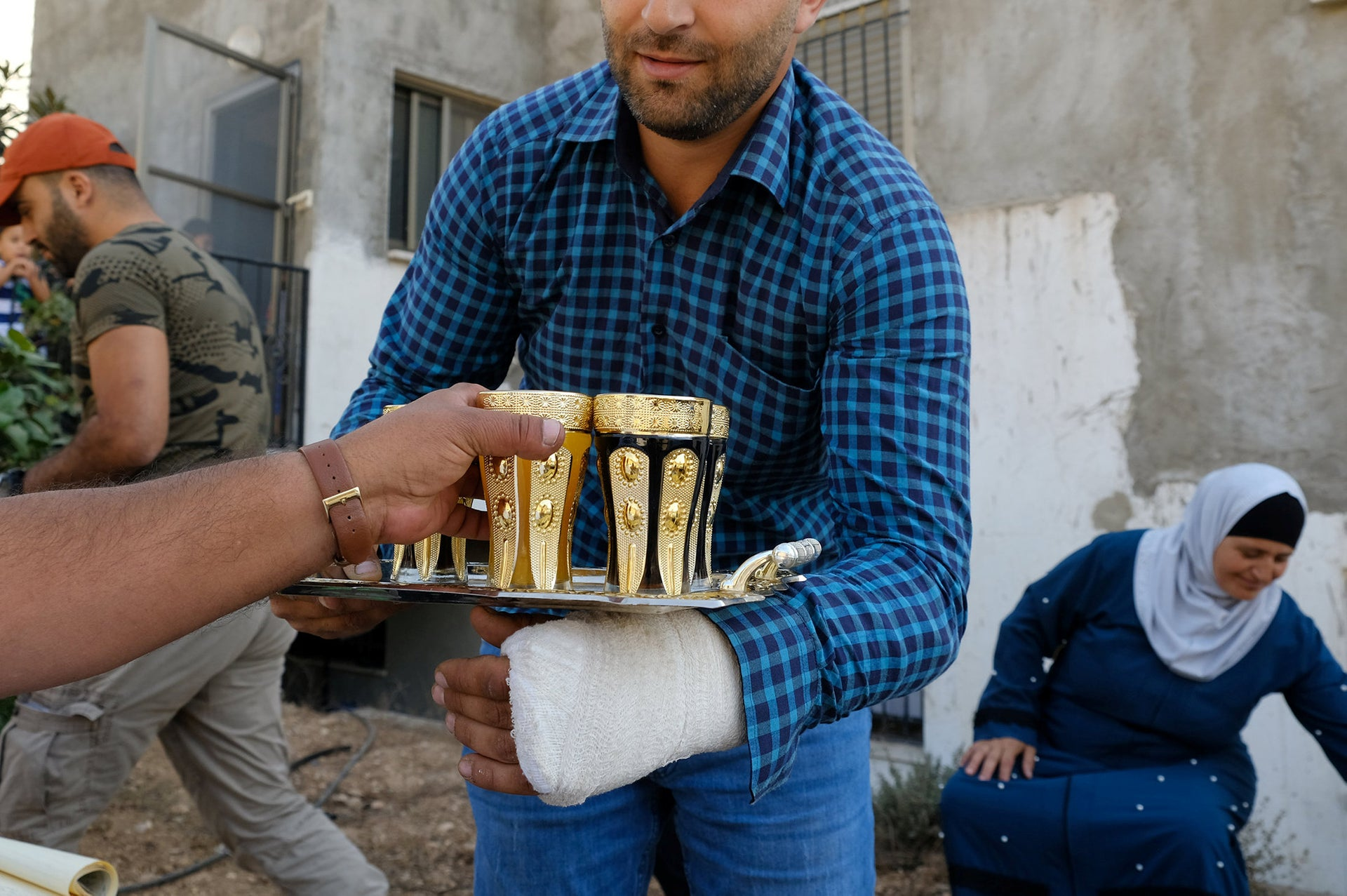 One of Imad Zaben's sons, who asked his name not be used, his hand in a cast.