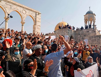 Palestinians protest in the al-Aqsa mosque compound, Islam's third holiest site, in the Old City of Jerusalem, October 30, 2020.