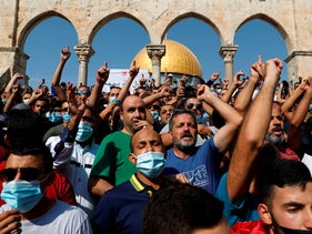 Palestinians protest against comments by French President Emmanuel Macron defending cartoons of the Prophet Mohammed, al-Aqsa mosque compound, Jerusalem, October 30, 2020.
