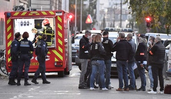 Security and emergency personnel in Lyon at the scene where an attacker armed with a sawn-off shotgun wounded an Orthodox priest in a shooting before fleeing, October 31, 2020