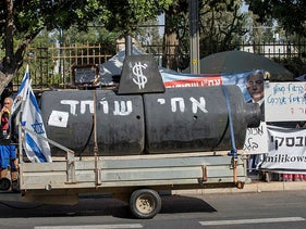 The Black Flag movement in Israel presents a replica of a submarine at a protest in front of the Prime Minister's residence in Jerusalem, August 3, 2020.