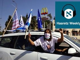 An Israeli woman gestures as she joins a convoy to the U.S. Embassy in Jerusalem to show support for President Donald Trump ahead of the November 3, 2020, election.