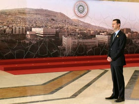 Syrian President Bashar Assad stands to receive Arab leaders before the opening session of the Arab Summit in Damascus, Syria, March 29, 2008.