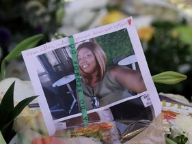 Portrait of a deadly knife attack victim is seen among flowers in front of the Notre Dame church in Nice, France, October 31, 2020