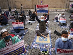 Members of an Italian Muslim association stage a sit-in and prayer to condemn what they see as persecutory acts against the Islamic community in France and against the publication of pictures and what they see as disrespect of the Prophet Muhammad, in Rome, October 30, 2020.