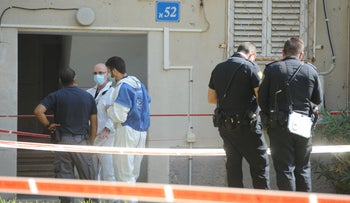 Law enforcement respond to the scene of a murder in Haifa, October 2020.
