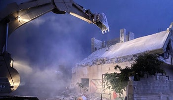 The Israeli army tears down the home of Palestinian Khalil Dweikat, who is charged with murder of Rabbi Shay Ohayon, village of Rujib near Nablus, November 2, 2020.