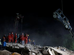 Members of rescue services work on the debris of a collapsed building in Izmir, Turkey, November 1, 2020.