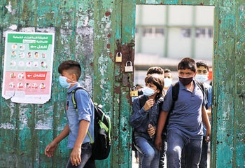 Palestinian students leave their school as schools partially reopened amid the coronavirus disease outbreak, in the Gaza Strip, October 27, 2020