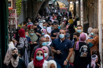 Palestinian procession marking the birthday of the Prophet Mohammed in the Muslim quarter of Jerusalem's Old City, Oct. 29, 2020