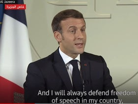 Emmanuel Macron: violence not an acceptable response to cartoons of Muhammad